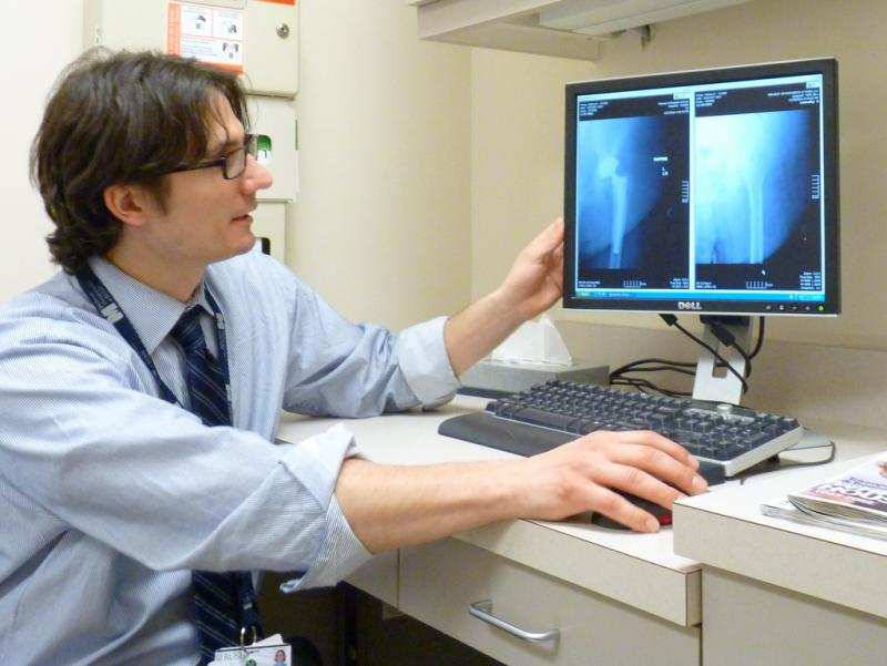 Physician looking at X-ray images