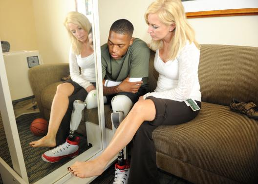 Therapist helping basketball player with false leg
